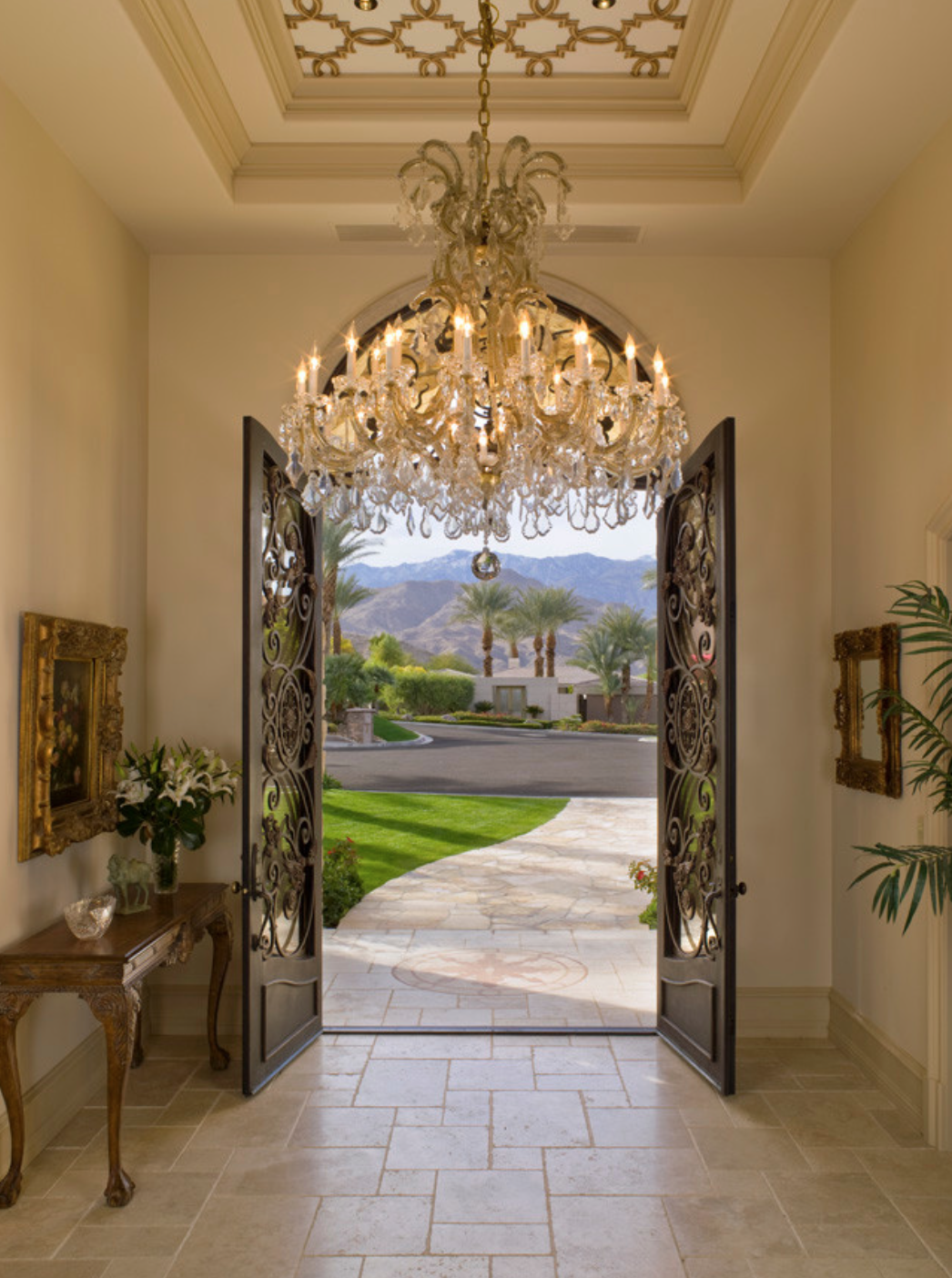 Keep this area welcoming and abstract-- we suggest saving any family photos or anything super personal for down the hall. That's a great way to keep an entry way formal, as well--like in this Palm Spring Home.