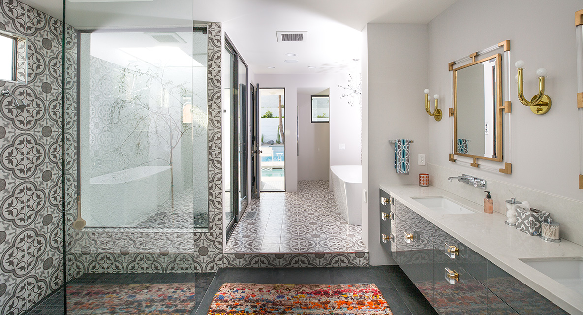 You know we love a good geometric statement tile! We can find a way to make them work in just about any style home, but they're an intrinsic piece in any mid-century Moroccan home. It's a great way to get creative and custom in your home, especially in the bathroom. We love how this ceramic tile floor continues up the bathroom wall.