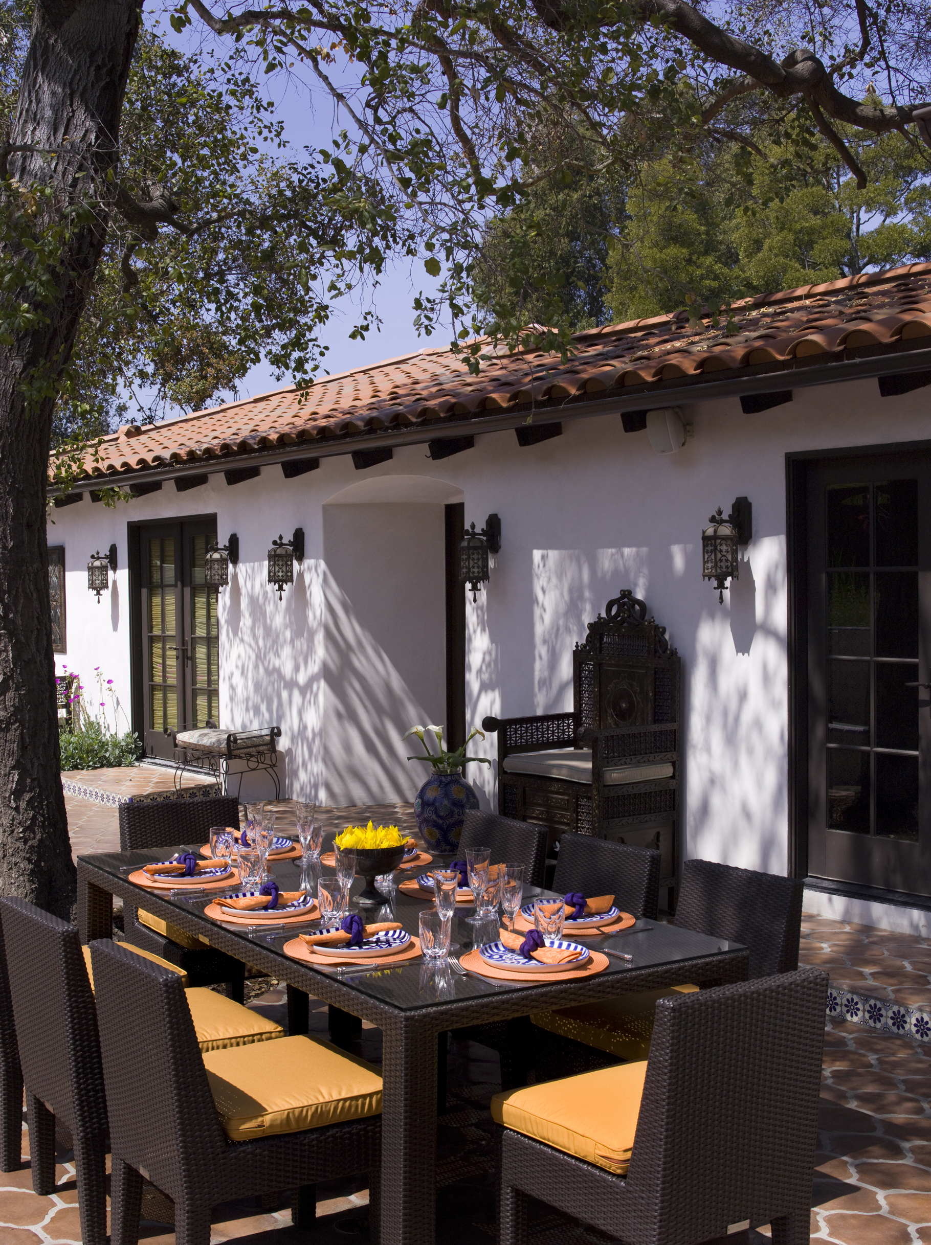 Dining Al Fresco at a Lori Dennis Spanish home