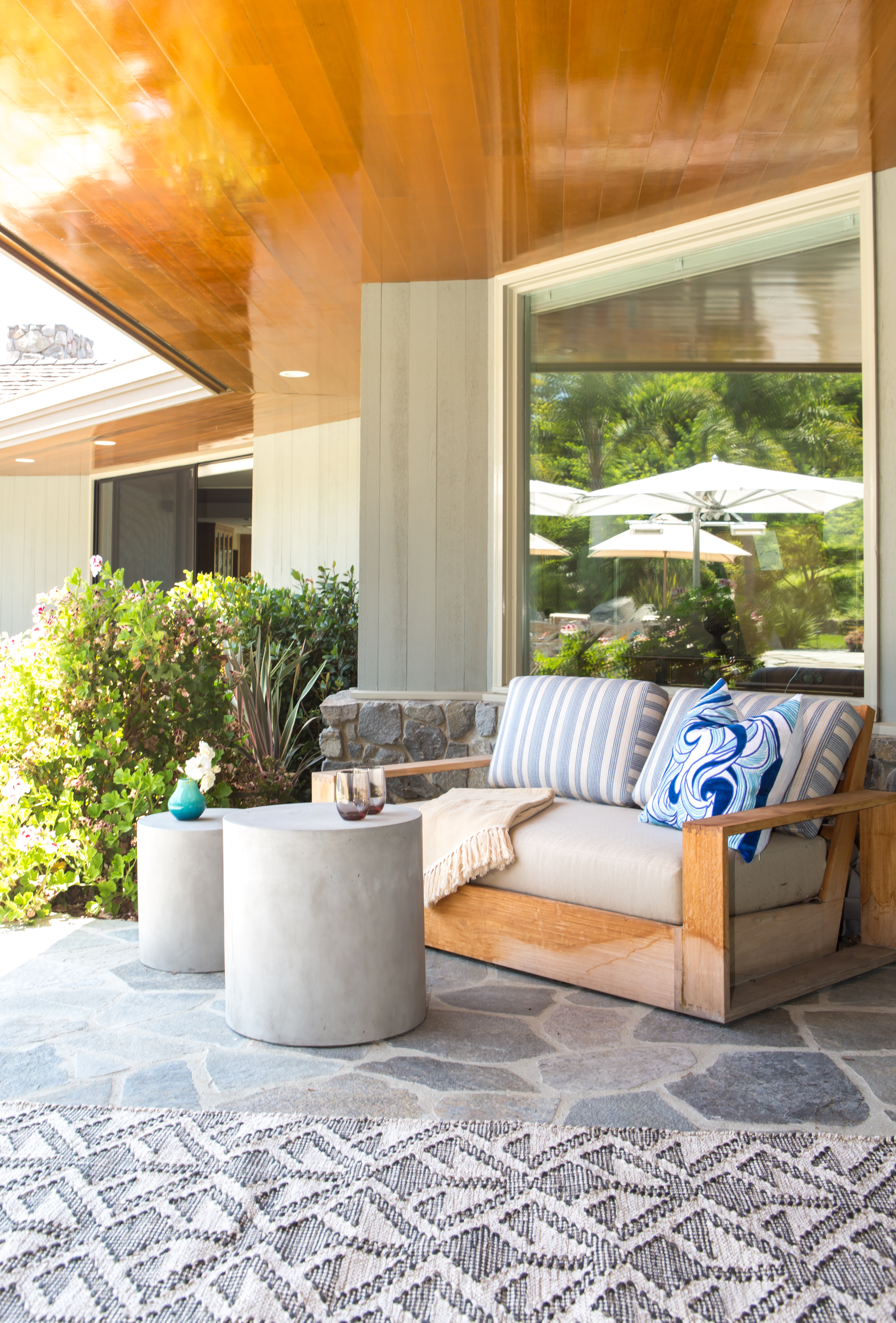 We work on some incredible indoor-outdoor living spaces and in order to seamlessly transition from indoor to out, we utilize durable fabrics and materials that could just as easily be included inside!