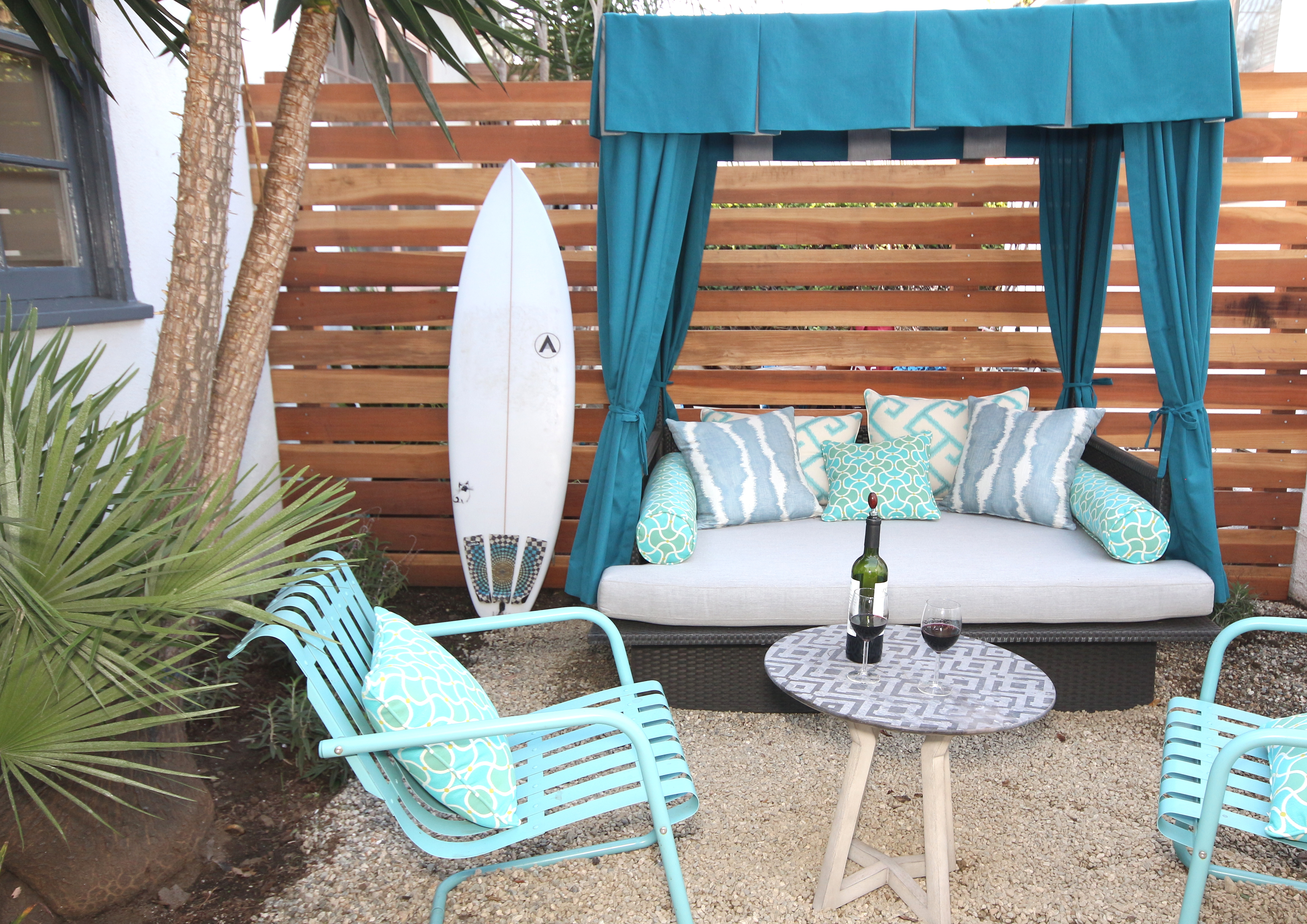 Cabana and outdoor lounge complete with Lamps Plus outdoor chairs and Calico Sunbrella outdoor fabrics