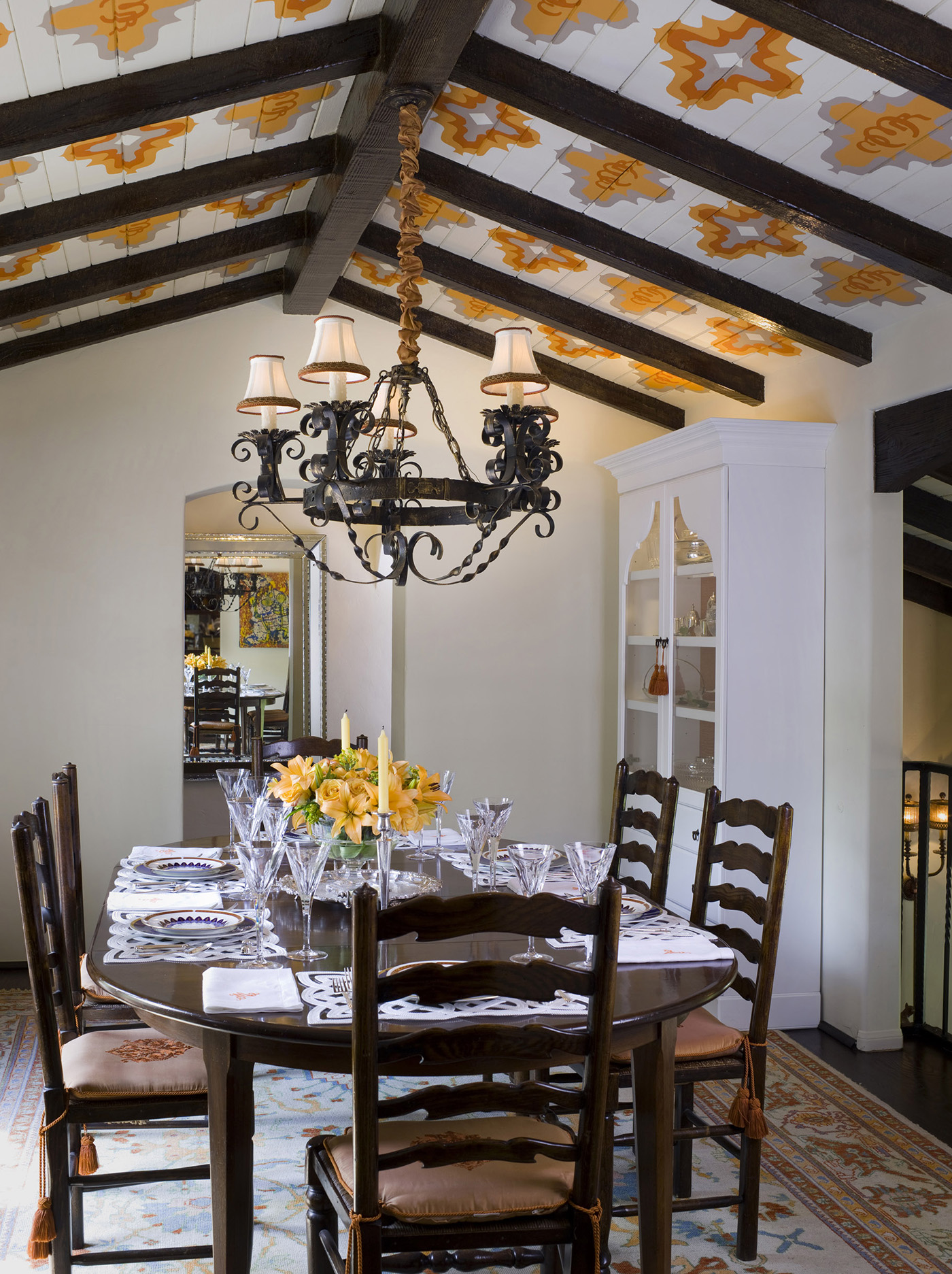 """The theme for this project was """"Austin Powers Goes to Spain."""" And we accomplished that Hip Hacienda style by infusing theme into every minute detail: Can you say throwback? We utilized some Beaded trim on the tassels, and the detailed ceilings are among our favorite architectural details."""