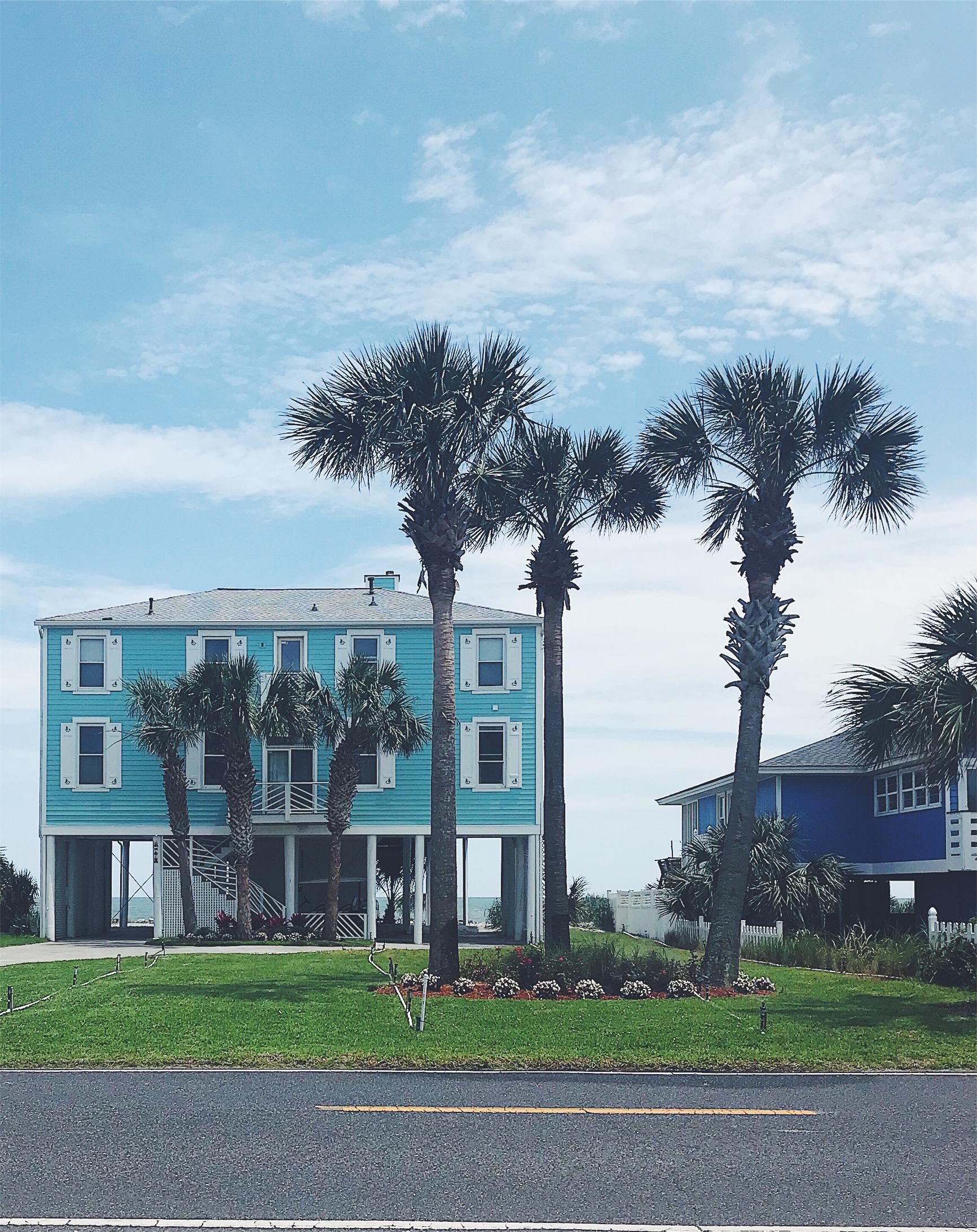 Blue beach house on piers