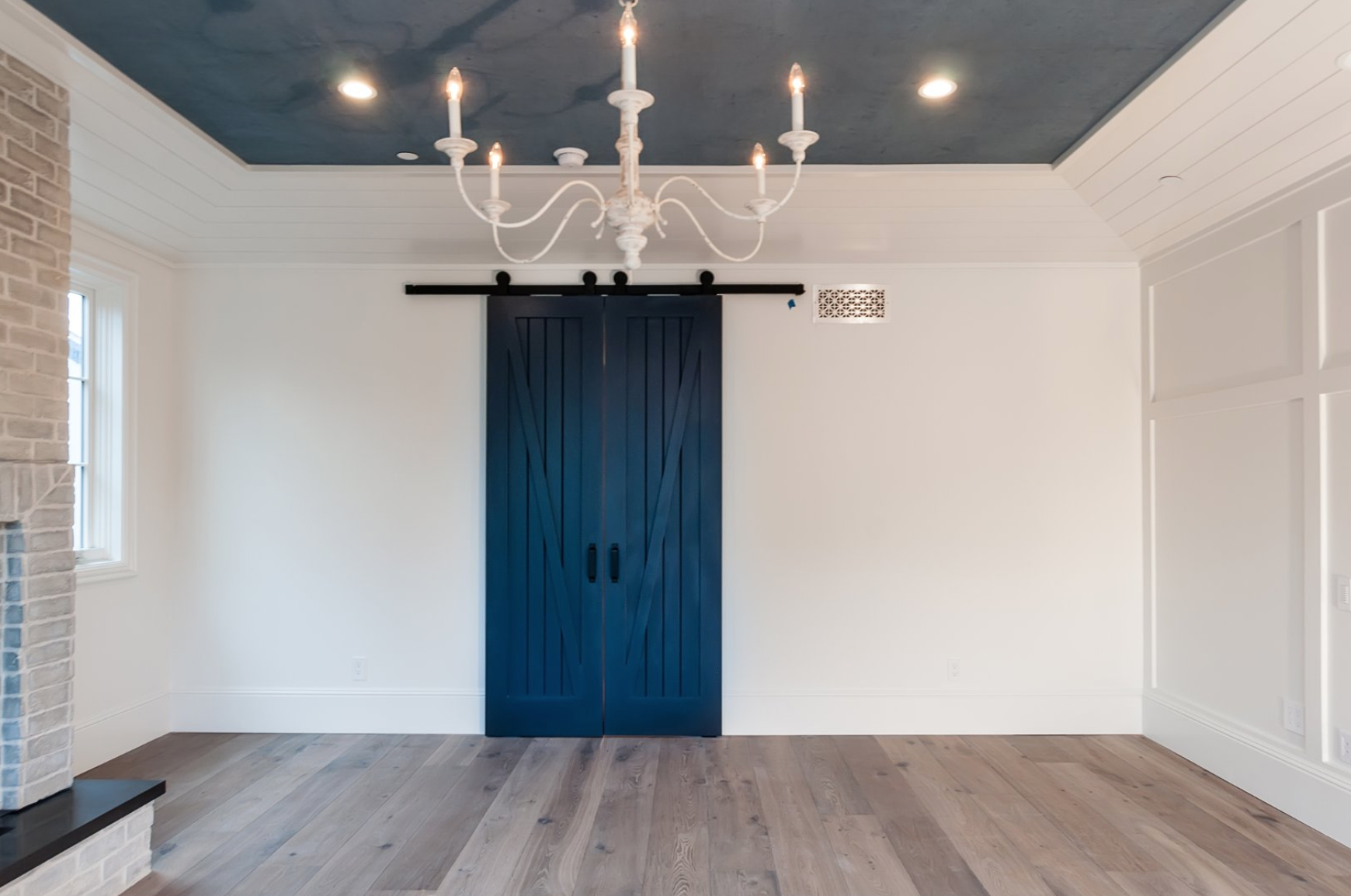 barn doors painted in modern, funky colors as both a design statement and as a way to make a room more flexible, you can section off a smaller room or keep it open.