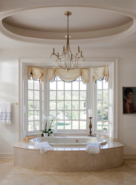 chandelier over bathtub traditional bathroom designed by Lori Dennis