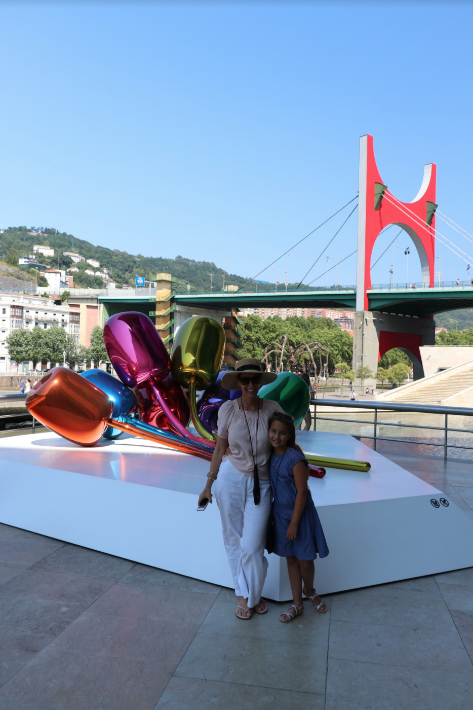 Lori Dennis with her daughter outside the Bilbao Guggenheim
