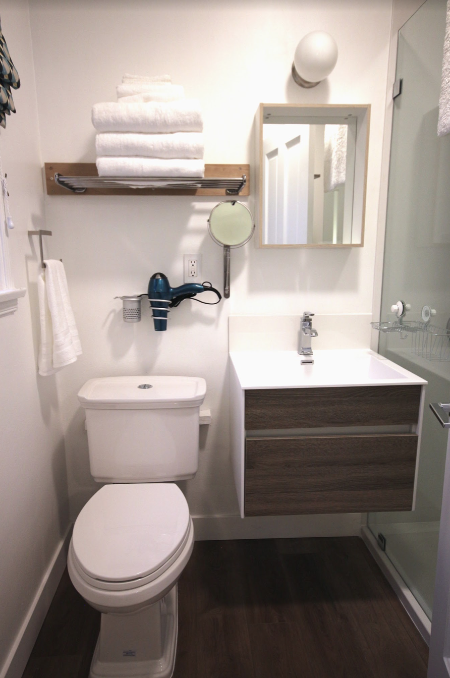 Vacation Rental Renovations: Should They Be Trendy or Timeless? all white modern bathroom in a vacation rental in Los Angeles